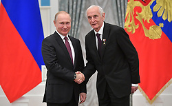 April 29, 2019 - Moscow, Russia - April 29, 2019. - Russia, Moscow. - Russian President Vladimir Putin (left) presents actor Vasily Lanovoy with a Hero of Labour of the Russian Federation medal at a ceremony at the Moscow Kremlin. (Credit Image: © Russian Look via ZUMA Wire)