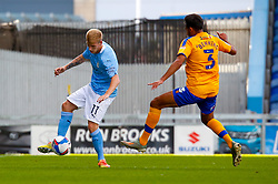 Malvind Benning of Mansfield Town attempts to block a through ball by Sammy Robinson of Manchester City - Mandatory by-line: Ryan Crockett/JMP - 08/09/2020 - FOOTBALL - One Call Stadium - Mansfield, England - Mansfield Town v Manchester City U21 - Leasing.com Trophy