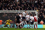 Mesut Ozil of Arsenal (L) takes a free kick which is blocked by Tottenham Hotspur players in the wall. Premier league match, Tottenham Hotspur v Arsenal at Wembley Stadium in London on Saturday 10th February 2018.<br /> pic by Steffan Bowen, Andrew Orchard sports photography.