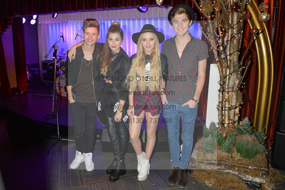 Pop Group Only The Young - l-r, CHARLIE GEORGE, PARISA TARJOMANI, BETSY-BLUE ENGLISH and MIKEY BROMLEY at the Quintessentially Foundation and The Crown Estate's Fayre of St.James' on 27th November 2014.  The evening started with a christmas concert at St.James's Church, Piccadilly.  Following the concert singer Leona Lewis switched on the Jermyn Street Christmas lights and then guests had a party at the newly refurbished Quaglino's, 16 Bury Street, London