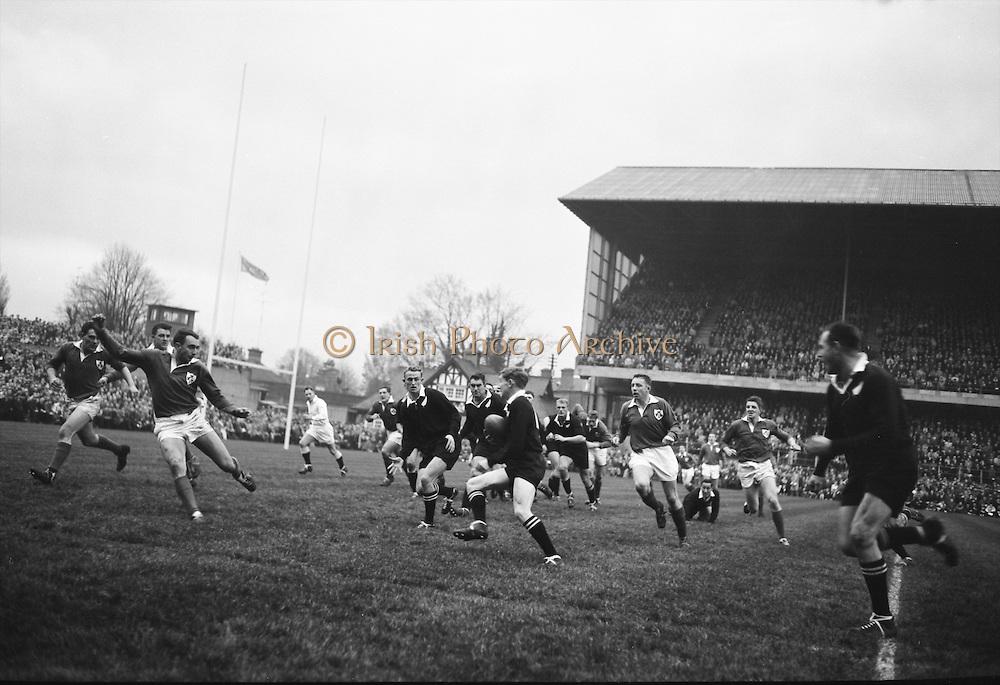 New Zealand forward S T Meads, in possession, runs for the Irish line, with Ronnie Dawson of Ireland on right,..Irish Rugby Football Union, Ireland v New Zealand, Tour Match, Landsdowne Road, Dublin, Ireland, Saturday 7th December, 1963,.7.12.1963, 12.7.1963,..Referee- H Keenen, Rugby Football Union, ..Score- Ireland 5 - 6 New Zealand, ..Irish Team, ..T J Kiernan, Wearing number 15 Irish jersey, Full Back, Cork Constitution Rugby Football Club, Cork, Ireland,..J Fortune, Wearing number 14 Irish jersey, Right Wing, Clontarf Rugby Football Club, Dublin, Ireland,..P J Casey, Wearing number 13 Irish jersey, Right Centre, University College Dublin Rugby Football Club, Dublin, Ireland, ..J C Walsh,  Wearing number 12 Irish jersey, Left Centre, University college Cork Football Club, Cork, Ireland,..A T A Duggan, Wearing number 11 Irish jersey, Left Wing, Landsdowne Rugby Football Club, Dublin, Ireland,..M A English, Wearing number 10 Irish jersey, Stand Off, Landsdowne Rugby Football Club, Dublin, Ireland, ..J C Kelly, Wearing number 9 Irish jersey, Captain of the Irish team, Scrum Half, University College Dublin Rugby Football Club, Dublin, Ireland,..P J Dwyer, Wearing number 1 Irish jersey, Forward, University College Dublin Rugby Football Club, Dublin, Ireland, ..A R Dawson, Wearing number 2 Irish jersey, Forward, Wanderers Rugby Football Club, Dublin, Ireland, ..R J McLoughlin, Wearing number 3 Irish jersey, Forward, Gosforth Rugby Football Club, Newcastle, England, ..W J McBride, Wearing number 4 Irish jersey, Forward, Ballymena Rugby Football Club, Antrim, Northern Ireland,..W A Mulcahy, Wearing number 5 Irish jersey, Forward, Bective Rangers Rugby Football Club, Dublin, Ireland,  ..E P McGuire, Wearing number 6 Irish jersey, Forward, University college Galway Football Club, Galway, Ireland,  ..P J A O' Sullivan, Wearing  Number 8 Irish jersey, Forward, Galwegians Rugby Football Club, Galway, Ireland,..N A Murphy, Wearing number 7 Irish jersey, Forward, Cork Constitu