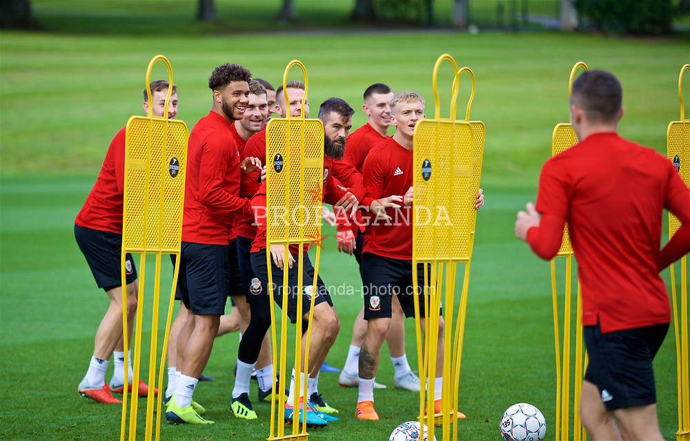 CARDIFF, WALES - Friday, September 7, 2018: Wales players play tag during a training session at the Vale Resort ahead of the UEFA Nations League Group Stage League B Group 4 match between Denmark and Wales. Tyler Roberts, Joe Ledley, Matthew Smith. (Pic by David Rawcliffe/Propaganda)