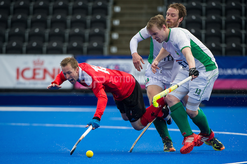 Holcombe's Barry Middleton is tackled by Michael Farrer and Ali Bray of Canterbury. Canterbury v Holcombe - Now: Pensions Finals Weekend, Lee Valley Hockey & Tennis Centre, London, UK on 11 April 2015. Photo: Simon Parker