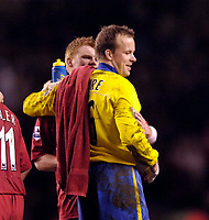 Photo: Jed Wee.<br />Liverpool v Charlton Athletic. The Barclays Premiership. 04/03/2006.<br />Charlton's Thomas Myhre (R) with fellow Norwegian John Arne Riise at the end of the match.