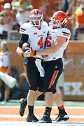 AUSTIN, TX - SEPTEMBER 26:  J.W. Walsh #4 of the Oklahoma State Cowboys celebrates after rushing for a 4 yard touchdown against the Texas Longhorns during the 1st quarter on September 26, 2015 at Darrell K Royal-Texas Memorial Stadium in Austin, Texas.  (Photo by Cooper Neill/Getty Images) *** Local Caption *** J.W. Walsh