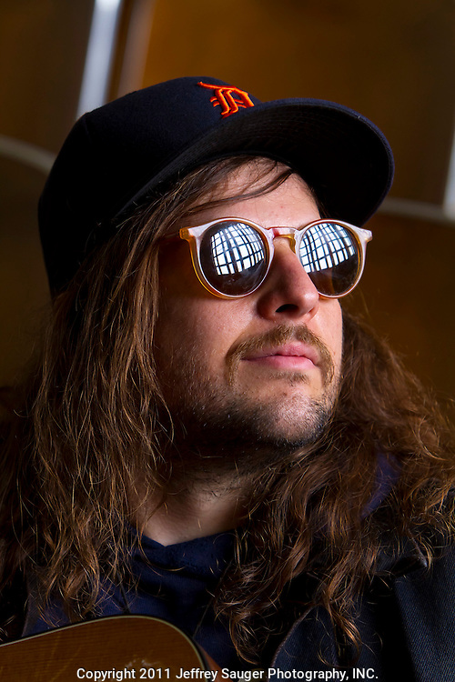 King Tuff, aka Kyle Thomas, poses for portraits at Malcolm X Academy --an abandoned school that was purchased by a real estate developer and rented out as, among other things, a recording studio-- in Detroit, MI, while recording with Robert Harlow, of The Go and Conspiracy of Owls, Thursday, July 7, 2011. (Photo By Jeffrey Sauger)