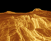 A portion of western Eistla Regio is shown in this three dimensional, computer-generated view of the surface of Venus. The viewpoint is at an elevation of 1.2 kilometres (0.75 mile) at a location 700 kilometres (435 miles) southeast of Gula Mons, the volcano on the right horizon. Gula Mons reaches 3 kilometres (1.8 miles) high and is located around 22 degrees north latitude and 359 degrees east longitude. Sif Mons, the volcano on the left horizon, has a diameter of 300 kilometres (186 miles) and a height of 2 kilometres (1.2 miles). Magellan imaging and altimetry data are combined to develop a three-dimensional computer view of the planet's surface. Simulated colour based on colour images from the Soviet Venera 13 and 14 spacecraft is added to enhance small-scale structure.1990.