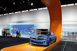 08  February 2013: 2013 Chevrolet Performance Camero - Hot Wheels Edition. Chicago Auto Show, Chicago Automobile Trade Association (CATA), McCormick Place, Chicago Illinois<br /> <br /> 2013 CHEVROLET CAMARO: One of America's most popular sporty cars, the retro Chevrolet Camaro, is now in its fourth year and available in four rear-wheel-drive models - LS, LT, SS and ZL1. The 2013 LS and LT come fitted with a more powerful and efficient version of the 3.6-liter direct-injected V-6. The new engine is 20.5 pounds lighter than previous sixes, and delivers 323 horsepower - yet, offers an estimated 30 mpg on the highway. A 6.2L V-8, with up to 426 hp is standard in the SS coupe and convertible. Camaro engines can be mated to a six-speed manual or six-speed automatic transmission. For the ultra-performance enthusiast, Chevy offers the 'barely street legal' Camaro ZL1. It packs a 580-horsepower version of the 6.2L V-8, boosted by an intercooled Eaton supercharger and is mated to either a six-speed automatic or manual. The ZL1 Coupe accelerates from 0 to 60 mph in 3.9 seconds and can reach a top speed of 184 mph. Like the ZL1, all Camaro SS models now feature variable-effort electric power steering and an available dual-mode exhaust system on manual transmission-equipped models. In addition to the new performance features the 2013 Camaro models offer a unique Blue Ray Metallic exterior color, frameless inside rearview mirror, Mojave leather interior trim, remote vehicle start, color-touch radio, and new 18-inch and 20-inch wheel designs.