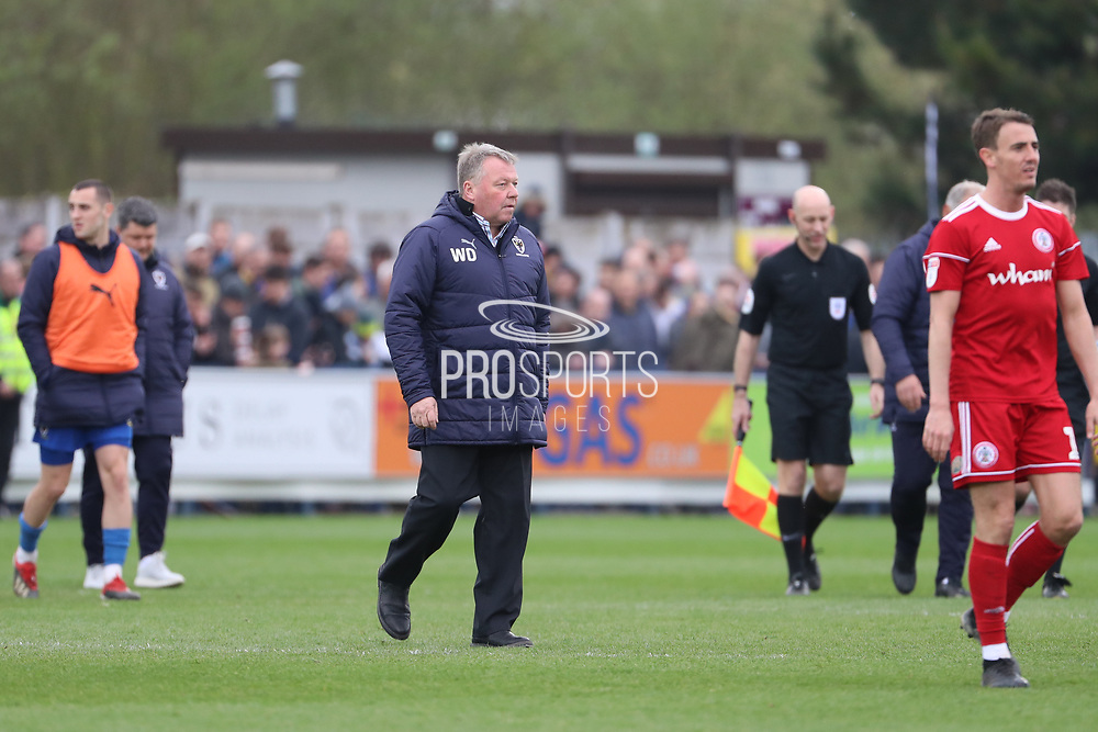 AFC Wimbledon manager Wally Downes walking off the pitch during the EFL Sky Bet League 1 match between AFC Wimbledon and Accrington Stanley at the Cherry Red Records Stadium, Kingston, England on 6 April 2019.