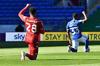 Football - 2020 / 2021 EFL Sky Bet Championship - Cardiff City vs Reading<br /> <br /> Josh Laurent v & Junior Hoilett of Cardiff City take the knee<br /> , at the Cardiff City Stadium.