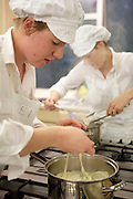 May0017375 . Daily Telegraph..Pic shows Isobel Nicholson cooking fresh taglietelle..Students at the private boarding school Dowe House who are taking a special two year cookery course devised by catering company Leith's.In this particular class taught by Puff Fairclough the girls learnt how to make basil pesto and fresh parsley pasta...Thatcham 12 October 2009