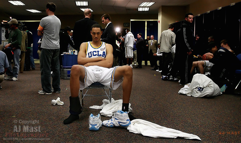 4/3/06 -- Indianapolis, IN, U.S.A.UCLA's Ryan Hollins sits alone in the middle of his team's locker room following their 73-57 loss to Florida in the Final Four national championship basketball game in Indianapolis, Monday, April 3, 2006... -- NCAA Final Four Championship --- University of UCLA Bruins vs University of Florida Gators at RCA Dome Monday April 3, 2006......photo by AJ Mast / Contract..Photo by AJ Mast, USA TODAY contract photographer .
