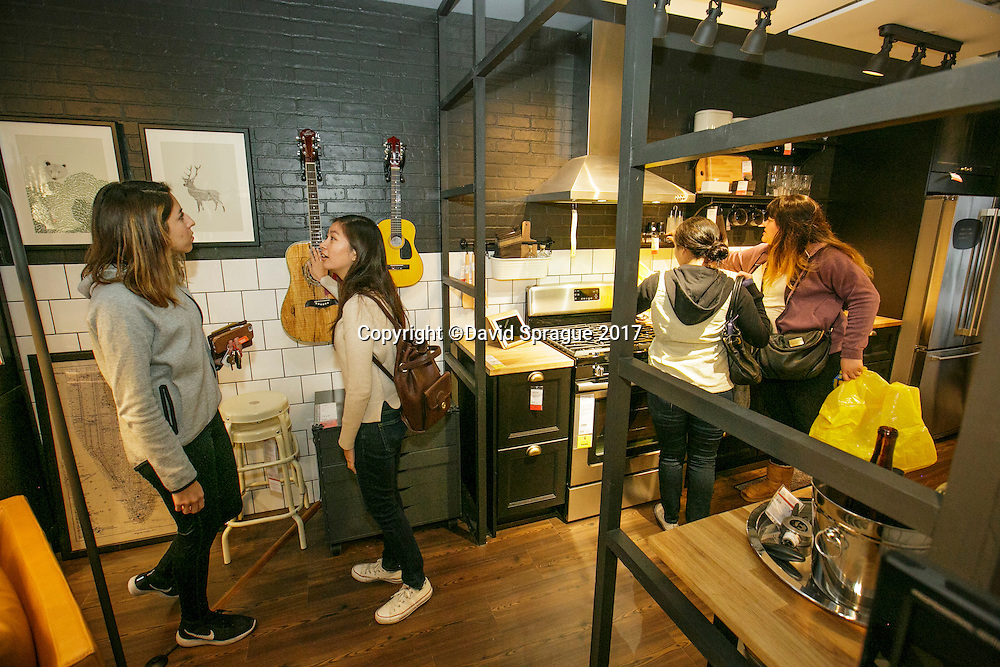 Customers check out a kitchen at the grand opening of the new Ikea in Burbank. The new Ikea store comes in at 456,000 sf, compared to the old one at 242,000 sf. And 1,700 parking places.  Feb. 8, 2017  Photo by David Sprague