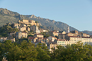 Town on hill under clear sky, Corte, Corsica, France