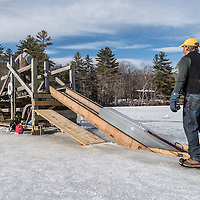Ice Harvest at on Squam Lake by Rockywold Deephaven Camps. John Jurczynski, Co-General Manager, guides the ice up the ladder.