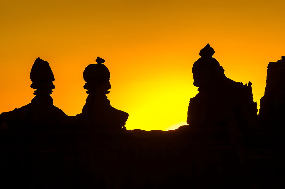 Sunrise behind rock formations, Goblin Valley State Park, near Hanksville, Utah, USA