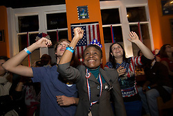 © licensed to London News Pictures. London, UK. 06/11/2012. Members of the DAUK (Democrats Abroad UK) gather at  Sports Bar & Grill in Marylebone, London to watch Barack Obama win a second term as President of The United States of America, defeating Mitt Romney. Photo credit: Tolga Akmen/LNP