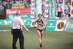10062018 (Durban) A position 8th Sarah Bard run towards the finnish line during the 2018 Comrades marathon in Durban.<br /> Picture: Motshwari Mofokeng/ANA