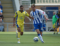 Photo: Tony Oudot/Richard Lane Photography.Colchester United v Leeds United. Coca Cola League One. 29/08/2009. <br /> Jason Crowe of Leeds challenges Scott Vernon of Colchester