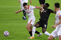 SEVILLE, SPAIN - OCTOBER 28: Munir of FC Sevilla and Jeremy Doku of Stade Rennais during the UEFA Champions League Group E stage match between FC Sevilla and Stade Rennais at Estadio Ramon Sanchez-Pizjuan on October 28, 2020 in Seville, Spain. (Photo by Juan Jose Ubeda/ MB Media).