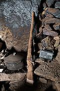 Guns and radio at a shepherd hut. In Zardibar. .Trekking back down from the Little Pamir, with yak caravan, over the frozen Wakhan river.