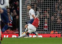 Football - 2018 / 2019 Premier League - Arsenal vs. Tottenham Hotspur<br /> <br /> Alexandre Lacazette (Arsenal FC) slips as he strikes home his teams third goal at The Emirates.<br /> <br /> COLORSPORT/DANIEL BEARHAM