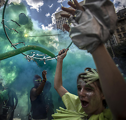 May 26, 2019 - Sao Paulo, Brazil - Grupo makes artistic intervention celebrating the Atlantic Forest Day on the steps of the Municipal Theater. (Credit Image: © Cris Faga/ZUMA Wire)