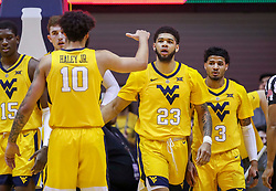 Dec 8, 2018; Morgantown, WV, USA; West Virginia Mountaineers forward Esa Ahmad (23) celebrates with teammates during the first half against the Pittsburgh Panthers at WVU Coliseum. Mandatory Credit: Ben Queen-USA TODAY Sports