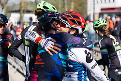 Birthday hugs for Carmen Small from Lisa Brennauer - Flèche Wallonne Femmes - a 137km road race from starting and finishing in Huy on April 20, 2016 in Liege, Belgium.
