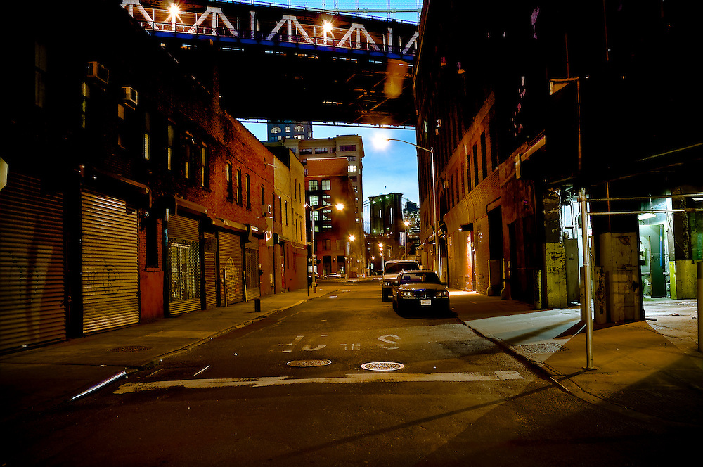 Sight of the Brooklyn Bridge by night from Plymouth street in DUMBO, Brooklyn, New York, 2009.