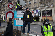 December, 8th, 2018 - Paris, Ile-de-France, France: Demonstrators on Champs Elysees.  The French 'Gilets Jaunes' demonstrate a fourth day. Their movement was born against French President Macron's high fuel increases. They have been joined en mass by students and trade unionists unhappy with Macron's policies. Nigel Dickinson