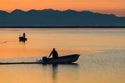 Fishermen at sunset, Dungeness Bay, October, Strait of Juan de Fuca, Salish Sea, Olympic Peninsula, Washington, USA
