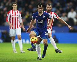 Shinji Okazaki of Leicester City (C) and Erik Pieters of Stoke City in action - Mandatory byline: Jack Phillips/JMP - 23/01/2016 - FOOTBALL - King Power Stadium - Leicester, England - Leicester City v Stoke City - Barclays Premier League