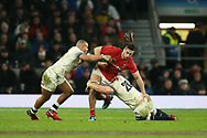 Josh Navidi of Wales tries to go past Jonathan Joseph (l) and Sam Underhill ® of England. England v Wales, NatWest 6 nations 2018 championship match at Twickenham Stadium in Middlesex, England on Saturday 10th February 2018.<br /> pic by Andrew Orchard, Andrew Orchard sports photography
