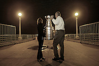 3 April 2004: The NHL Hall of Fame Stanley Cup portrait being held by Mr. & Mrs. Larry Robinson at midnight in the summer on the Manhattan Beach Pier in Los Angeles, CA.