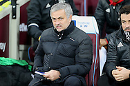 Jose Mourinho, the Manchester United looking on from his dugout seat.  Premier league match, West Ham Utd v Manchester Utd at the London Stadium, Queen Elizabeth Olympic Park in London on Monday 2nd January 2017.<br /> pic by John Patrick Fletcher, Andrew Orchard sports photography.
