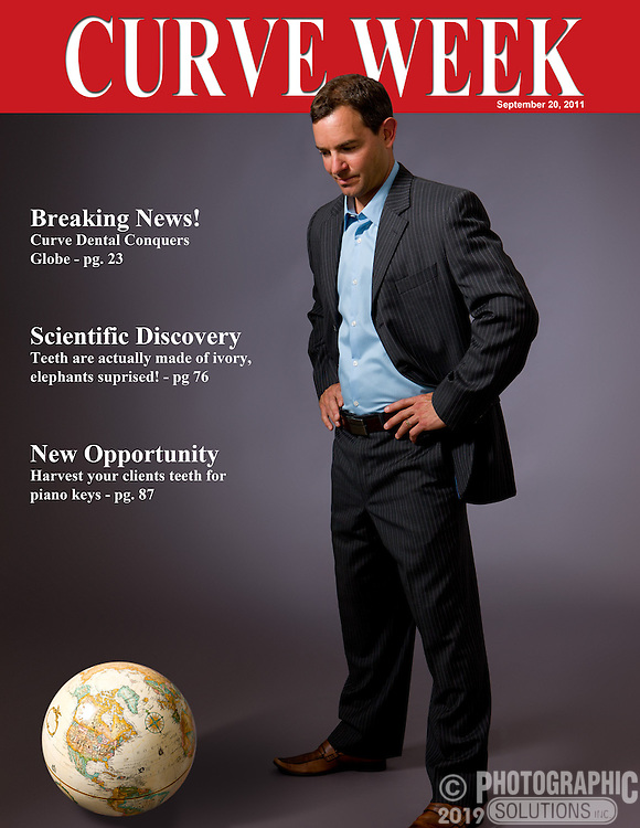Cover shot with Globe of a suited executive