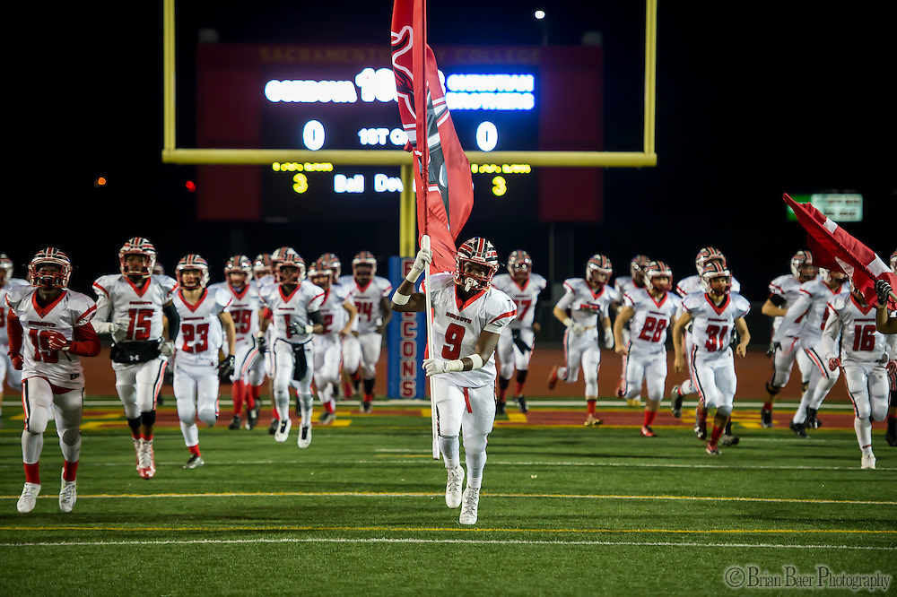 The Cordova Lancers come on the to the field before the Sac-Joaquin Section Division I football playoff game between the Christian Brothers Falcons and Cordova Lancers at Huges Stadium,  Friday Nov 11, 2016.<br /> photo by Brian Baer