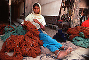 INDIA, RAJASTHAN, CRAFTS a young woman sorting wool for carpets  a craft shop in Jaipur