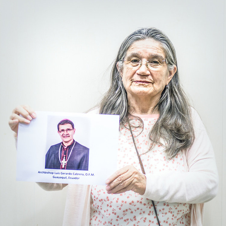2018<br /> Sara Oviedo, an activist that was the former vicepresident of the UN Commitee for the Rights of the Child, poses for a portrait showing a picture of the Archbishop Luis Gerardo Cabrera who is implicated in two abuse cases in Ecuador, that became public in spring 2018. © Simone Padovani