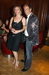Fashion designer BEN DE LISI and MISS DEBBIE LOVEJOY at a party hosted by jewellers Adler to celebrate 20 years in London held at 5 Cavendish Square, London on 4th May 2005.<br /><br />NON EXCLUSIVE - WORLD RIGHTS