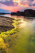 Amazing summer sunset by the coast of Oil Cape
