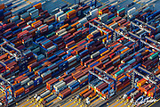 Aerial view of shipping containers in a New York Harbor port on the New Jersey Side, photographed at sunrise from a helicopter.