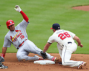 ATLANTA, GA - JULY 27:  Centerfielder John Jay #19 of the St. Louis Cardinals slides in to second base under the tag of second baseman Dan Uggla #26 of the Atlanta Braves during the game at Turner Field on July 27, 2013 in Atlanta, Georgia.  (Photo by Mike Zarrilli/Getty Images)