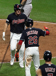 October 6, 2017 - Cleveland, OH, USA - The Cleveland Indians' Jay Bruce is congratulated by Austin Jackson (26) on his solo home run against the New York Yankees that tied the game in the eighth inning during Game 2 of the American League Division Series, Friday, Oct. 6, 2017, at Progressive Field in Cleveland. (Credit Image: © Mike Cardew/TNS via ZUMA Wire)