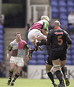Reading, England, Will GREENWOOD, jumpig to collect the high ball, European Shield Final, at the Madejski Stadium, NEC Harlequins v RC Narbonne.<br /> [Mandatory Credit, Peter Spurrier/ Intersport Images].