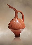 Terra cotta Hittite beaker shaped spouted pitcher - 1700 BC to 1500BC - Kültepe Kanesh - Museum of Anatolian Civilisations, Ankara, Turkey,  Against a warm art  background .<br /> <br /> If you prefer to buy from our ALAMY STOCK LIBRARY page at https://www.alamy.com/portfolio/paul-williams-funkystock/hittite-art-antiquities.html  - Type Kultepe  into the LOWER SEARCH WITHIN GALLERY box. Refine search by adding background colour, place, museum etc<br /> <br /> Visit our HITTITE PHOTO COLLECTIONS for more photos to download or buy as wall art prints https://funkystock.photoshelter.com/gallery-collection/The-Hittites-Art-Artefacts-Antiquities-Historic-Sites-Pictures-Images-of/C0000NUBSMhSc3Oo