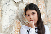 Young girl of 9 in deep thought