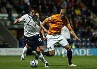 Photo: Paul Thomas/Sportsbeat Images.<br /> Preston North End v Hull City. Coca Cola Championship. 04/12/2007.<br /> <br /> Sean St Ledger (L) of Preston tries to get away from Caleb Forlan.