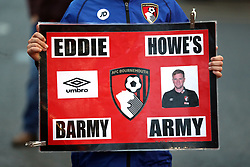 An AFC Bournemouth fan holds up a sign of manager Eddie Howe before the Carabao Cup, Fourth Round match at the Vitality Stadium, Bournemouth.